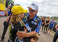 Mar 20, 2016; Gainesville, FL, USA; NHRA top fuel driver Brittany Force (left) celebrates with father John Force after winning the Gatornationals at Auto Plus Raceway at Gainesville. Mandatory Credit: Mark J. Rebilas-USA TODAY Sports