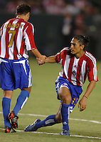 September 3, 2005 Photo by Matt A. Brown/ISI.Chivas USA (15 ) Juan Francisco Palencia gets a hand from teammate (7) Ramon Ramirez after be knocked down  against Columbus Crew in the first half.