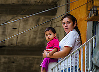 Urban Street Photograph of a Mexican mother with her child Puerto Vallarta Mexico