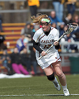 Boston College attacker Moira Barry (12) on the attack. .University of Maryland (black) defeated Boston College (white), 13-5, on the Newton Campus Lacrosse Field at Boston College, on March 16, 2013.