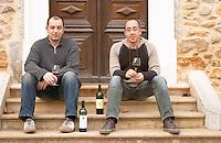 Laurent Reverdy, left, son of Patrick Reverdy, and his cousin Jean-Marc Bergès Chateau la Voulte Gasparets. In Gasparets village near Boutenac. Les Corbieres. Languedoc. Owner winemaker. France. Europe. Bottle.