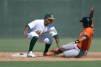 Oakland Athletics second baseman Chris Bostick (17) tags out a base running sliding into second during an instructional league game against the San Francisco Giants on September 27, 2013 at Papago Park Baseball Complex in Phoenix, Arizona.  (Mike Janes/Four Seam Images)