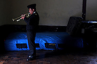 One of the Bolivian Navy band members pratices the trumpet in his room at the naval school in La Paz. Bolivia lost what is now northern Chile in a war over nitrates leaving Bolivia without access to the ocean.