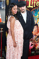 LOS ANGELES, CA, USA - OCTOBER 12: Actress Zoe Saldana and husband Marco Perego arrive at the Los Angeles Premiere Of Twentieth Century Fox and Reel FX Animation Studios' 'The Book of Life' held at Regal Cinemas L.A. Live on October 12, 2014 in Los Angeles, California, United States. (Photo by Xavier Collin/Celebrity Monitor)