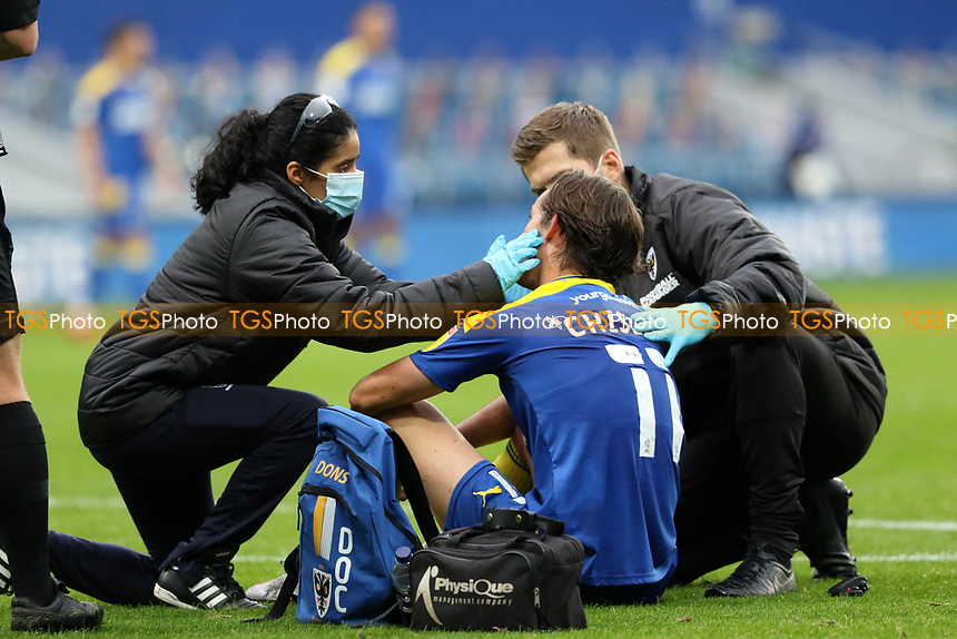 Ethan Chislett of AFC Wimbledon receiving treatment during AFC Wimbledon vs Shrewsbury Town, Sky Bet EFL League 1 Football at The Kiyan Prince Foundation Stadium on 17th October 2020