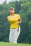 Hyun-Soo Kim of Korea plays a shot during the Hyundai China Ladies Open 2014 on December 10 2014 at Mission Hills Shenzhen, in Shenzhen, China. Photo by Li Man Yuen / Power Sport Images