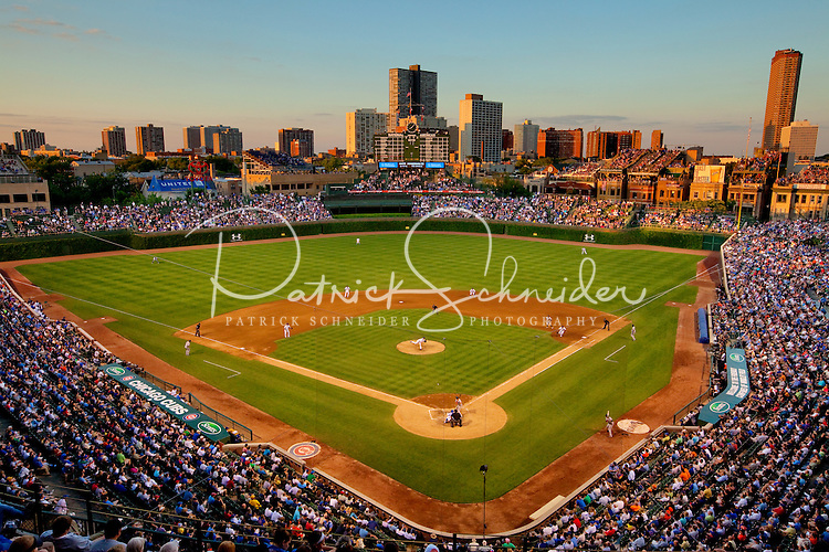 The setting sun casts a warm glow over Chicago's Wrigley Field baseball stadium during a 2011 game. Wrigley Field is home to the Chicago Cubs.