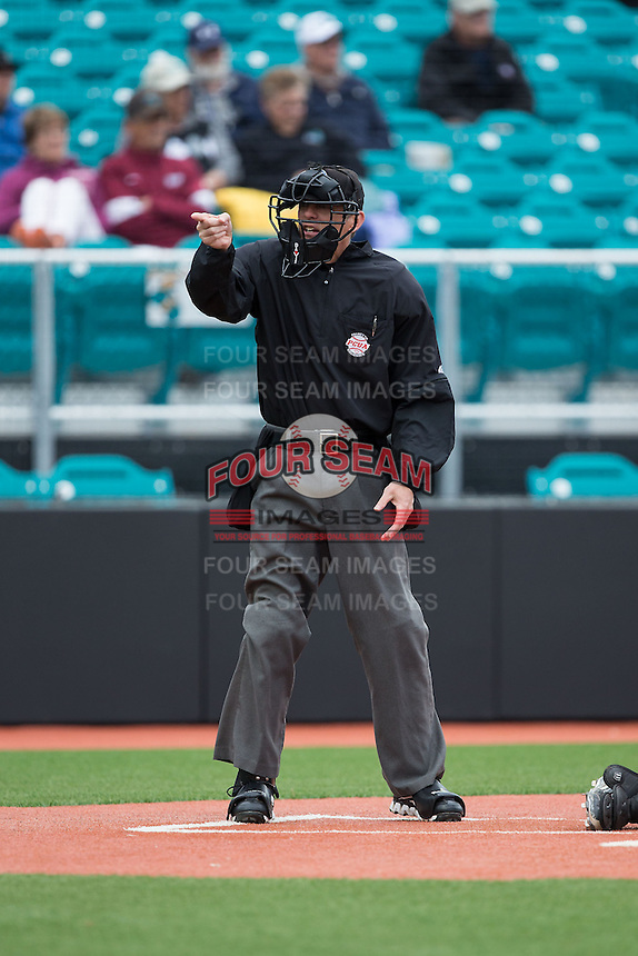 Home plate umpire Todd Drake makes a strike call during the NCAA baseball game between the Bryant Bulldogs and the Coastal Carolina Chanticleers at Springs Brooks Stadium on March 13, 2015 in Charlotte, North Carolina.  The Chanticleers defeated the Bulldogs 7-2.  (Brian Westerholt/Four Seam Images)