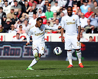 Pictured: Jonathan de Guzman takes a free kick which goes over the Manchester City cross bar. Saturday 04 May 2013<br /> Re: Barclay's Premier League, Swansea City FC v Manchester City at the Liberty Stadium, south Wales.