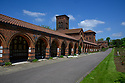 The sun bathes Golders Green Crematorium, on a May Bank Holiday, Golders Green, London, UK.