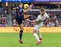 ORLANDO, FL - MARCH 05: Lynn Williams #13 of the United States fights for the ball with Keira Walsh #4 of England during a game between England and USWNT at Exploria Stadium on March 05, 2020 in Orlando, Florida.