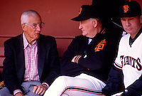 SAN FRANCISCO, CA - General manager Al Rosen and manager Roger Craig of the San Francisco Giants sit in the dugout before a game at Candlestick Park in San Francisco, California in 1987.  Photo by Brad Mangin