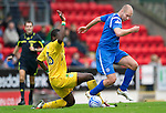 St Johnstone v Hibs...02.10.10  .Sam Parkin is tackled by Sol Bamba.Picture by Graeme Hart..Copyright Perthshire Picture Agency.Tel: 01738 623350  Mobile: 07990 594431