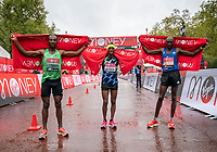 4th October 2020, London, England; 2020 London Marathon; (From left to right) Sisay Lemma (ETH), second place, Shura Kitata (ETH), winner, and Vincent Kipchumba (KEN), third place, celebrate after completing the Elite Men's Race. The historic elite-only Virgin Money London Marathon taking place on a closed-loop circuit around St James's Park in central London on Sunday 4 October 2020.