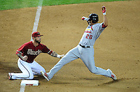 May 9, 2012; Phoenix, AZ, USA; St. Louis Cardinals pitcher Kyle Lohse (right) beats the tag by Arizona Diamondbacks third baseman Ryan Roberts in the fifth inning at Chase Field. Mandatory Credit: Mark J. Rebilas-