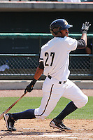 Jimmy Paredes #27 of the Charleston RiverDogs hitting in a game against the West Virginia Power on April 14, 2010  in Charleston, SC.