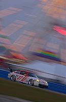 Rolex 24 at Daytona, Daytona International Speedway 5/6 Feb, 2005.The #37 TPC Racing Porsche races past the ferris wheel as darkness falls Saturday evening..Copyright©F.Peirce Williams 2005