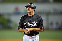 Birmingham Barons manager Omar Vizquel (13) during a Southern League game against the Chattanooga Lookouts on May 2, 2019 at Regions Field in Birmingham, Alabama.  Birmingham defeated Chattanooga 4-2.  (Mike Janes/Four Seam Images)