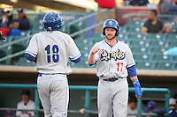 Kyle Garlick (17) of the Rancho Cucamonga Quakes greets teammate Johan Mieses (18) after scoring during a game against the Lancaster JetHawks at The Hanger on April 19, 2016 in Lancaster, California. Rancho Cucamonga defeated Lancaster, 10-6. (Larry Goren/Four Seam Images)