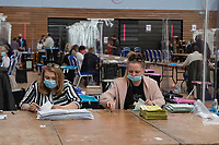 Pictured: Two ladies count ballot papers during The Swansea East and Gower Election Count at LC in Swansea, Wales, UK. Friday 07 May 2020
