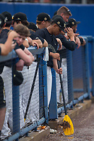 Christian Long (19) of the Wake Forest Demon Deacons uses an oar to move some water away from the dugout after a lengthy rain delay in Game Three of the Gainesville Super Regional of the 2017 College World Series against the Florida Gators at Alfred McKethan Stadium at Perry Field on June 12, 2017 in Gainesville, Florida.  The Gators defeated the Demon Deacons 3-0 to advance to the College World Series in Omaha, Nebraska.   (Brian Westerholt/Four Seam Images)
