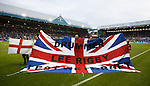 Sheffield Weds and Rangers fans with a banner in memorial to Lee Rigby