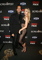HOLLYWOOD, CA - OCTOBER 12: Samuel Gonzalez Jr., Gigi Gustin, at the 21st Screamfest Opening Night Screening Of The Retaliators at Mann Chinese 6 Theatre in Hollywood, California on October 12, 2021. Credit: Faye Sadou/MediaPunch