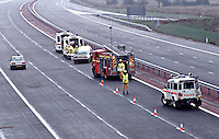 Firefighters and traffic police officers have closed off a motorway after a serious accident. They have closed both carriageways to enable the paramedic ambulance crews to work in safety...© SHOUT. THIS PICTURE MUST ONLY BE USED TO ILLUSTRATE THE EMERGENCY SERVICES IN A POSITIVE MANNER. CONTACT JOHN CALLAN. Exact date unknown.john@shoutpictures.com.www.shoutpictures.com...