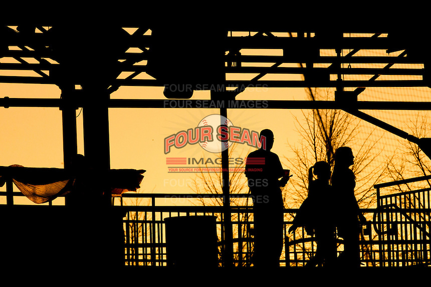 A fan watches from the main concourse during a game between the Purdue Boilermakers and the Missouri State Bears at Hammons Field on March 13, 2012 in Springfield, Missouri. (David Welker / Four Seam Images)