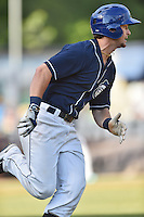 Asheville Tourists shortstop Brendan Rodgers (1) runs to first during a game against the Columbia Fireflies at McCormick Field on June 18, 2016 in Asheville, North Carolina. The Tourists defeated the Fireflies 5-4. (Tony Farlow/Four Seam Images)
