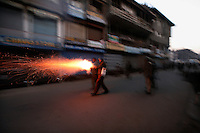 Police and paramilitary fire tear gas grenades at stone throwing youth, following protests over the arrest of  separatist leader Yasin Malik. Srinagar, Kashmir, India. © Fredrik Naumann/Felix Features