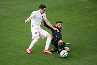LOS ANGELES, CA - MARCH 01: Diego Rossi #9 of LAFC slide tackles Lewis Morgan #7 of Inter Miami CF during a game between Inter Miami CF and Los Angeles FC at Banc of California Stadium on March 01, 2020 in Los Angeles, California.