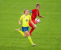 YOKOHAMA, JAPAN - AUGUST 6: Kosovare Asllani #9 of Sweden looks to the ball during a game between Canada and Sweden at International Stadium Yokohama on August 6, 2021 in Yokohama, Japan.