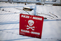 A sign warning for mines at the Sarajevo Tunnel museum, also known as Tunel spasa (English: Tunnel of rescue) and Tunnel of Hope. It is dedicated to the tunnel built by the Bosnian Army in order to link the city of Sarajevo, which was entirely cut off by Serbian forces, with Bosnian-held territory on the other side of the Sarajevo Airport, an area controlled by the United Nations. The tunnel enabled food, war supplies, and humanitarian aid to come into the city, and allowed people to get out. The tunnel became a major way of bypassing the international arms embargo and providing the city defenders with weaponry.