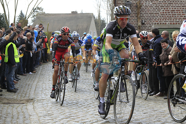 The peloton including Stuart O'Grady (AUS) GreenEdge Cycling Team and Alessandro Ballan (ITA) BMC Racing Team climb Molenberg during the 96th edition of The Tour of Flanders 2012, running 256.9km from Bruges to Oudenaarde, Belgium. 1st April 2012. <br /> (Photo by Eoin Clarke/NEWSFILE).