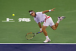 SHANGHAI, CHINA - OCTOBER 12:  David Ferrer of Spain returns a ball to Michael Llodra of France during day two of the 2010 Shanghai Rolex Masters at the Shanghai Qi Zhong Tennis Center on October 12, 2010 in Shanghai, China.  (Photo by Victor Fraile/The Power of Sport Images) *** Local Caption *** David Ferrer