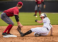 Huntington Beach Jake Vogel (27) slides into second base during a High School baseball game on March 5, 2019 in San Juan Capistrano, California.  (Terry Jack/Four Seam Images)