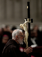 Friar Raniero Cantalamessa kisses the crucifix the Good Friday Passion of Christ Mass inside St. Peter's Basilica, at the Vatican, Friday, March 30, 2018. <br /> UPDATE IMAGES PRESS/Isabella Bonotto<br /> <br /> STRICTLY ONLY FOR EDITORIAL USE