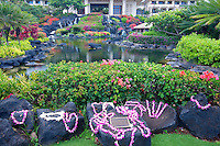 Leis on rocks at Grand Hyatt, Kauai, Hawaii.