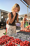 Lewisburg Farmers Market. Jennifer Novinger selecting fresh blueberries