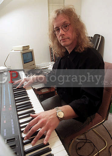 Warren Zevon plays a synthesizer in his West Hollywood, Calif., apartment in October 1989. Zevon, who wrote and sang the rock hit ``Werewolves of London'' and was among the wittiest and most original of a broad circle of singer-songwriters to emerge from Los Angeles in the 1970s, died on Sept. 7. He was 56..(Photo by Alan Greth).