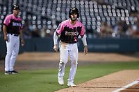 Luis Gonzalez (2) of the Charlotte Knights takes his lead off of third base against the Gwinnett Stripers at Truist Field on July 17, 2021 in Charlotte, North Carolina. (Brian Westerholt/Four Seam Images)