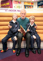 """*** NO FEE PIC*** 01/03/2012 Pictured is Irish Author Brendan O' Brien with third class children from Holy Cross National School Dundrum, Dublin (L to R) Twins Frankie Kelly Corrigan & Charlie Kelly Corrigan (9) at a free reading event of his book """" The Story of Ireland"""" in Eason Dundrum to celebrate the 15th annual World Book Day. To celebrate World Book Day Eason, Ireland's leading retailerof books, stationery, magazines & More have teamed up with some of Ireland'sleading children's writers to deliver a series of events in key stores to mark World Book Day. Photo: Gareth Chaney Collins"""