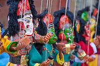 Kathmandu, Nepal.  Dolls of Ganesh, Son of Shiva, and Hanuman, in a Durbar Square Vendor's Shop.