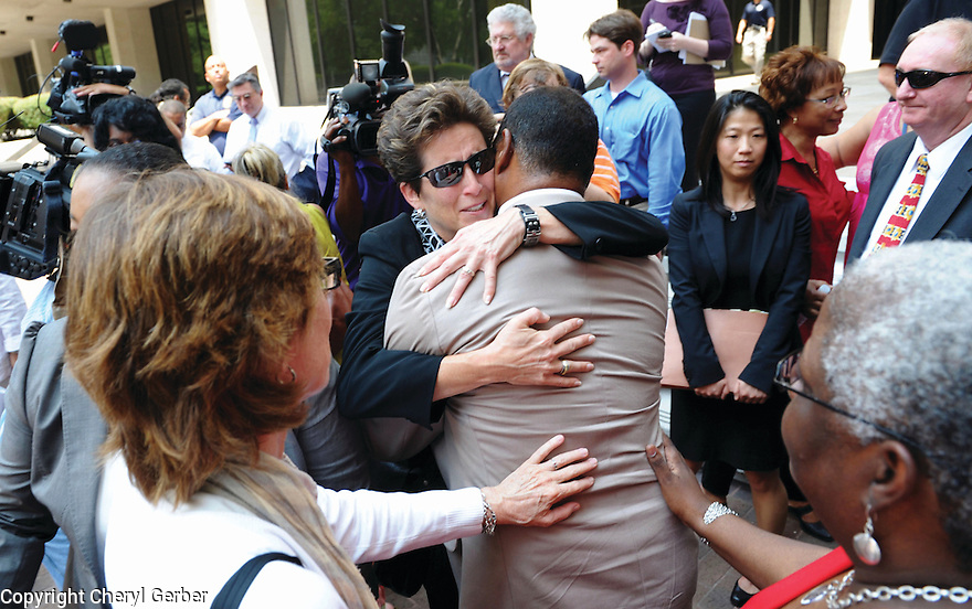 Lance Madison, whose brother Ronald Madison was killed by police officers during the aftermath of Hurricane Katrina, hugs Barbara 'Bobbi' Bernstein, lead prosecutor for the U.S. Justice Department, after the jury delivered guilty verdicts for all five officers charged with the crimes, 2011