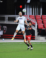 WASHINGTON, DC - AUGUST 25: Kelyn Rowe #11 of New England Revolution heads the ball against Edison Flores #10 of D.C. United during a game between New England Revolution and D.C. United at Audi Field on August 25, 2020 in Washington, DC.