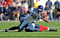 21 October 2007: Baltimore Ravens wide receiver Derrick Mason (85) is tackled by Buffalo Bills cornerback Jerametrius Butler during a game at Ralph Wilson Stadium in Orchard Park, NY. The Bills defeated the Ravens 19-14 in front of 70,727 fans marking their second win of the 2007 season...Mandatory Photo Credit: Ed Wolfstein Photo