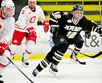 2 January 2011: Army Black Knight forward Mike Henderson, a Freshman from Bloomington, IN, in action against the Ohio State University Buckeyes at Gutterson Fieldhouse in Burlington, Vermont. The Buckeyes defeated the Black Knights 5-3 to win the 2010-2011 Catamount Cup. Mandatory Credit: Ed Wolfstein Photo