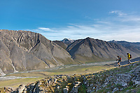 Hikers in the mountains bordering the Marsh Fork of the Canning River in the Arctic National Wildlife Refuge, Brooks Range mountains, Alaska.