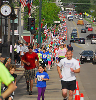 Kids and their parents run up Stoughton's Main Street at the 2010 Syttende Mai on Saturday, 5/15/10